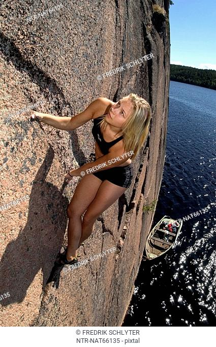 A woman rock climbing Sweden
