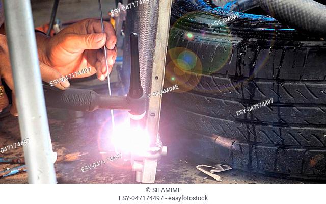 Repairing man made welding steel of valve auto air conditioning systems, how to fire at service car shop, Has copy space at right
