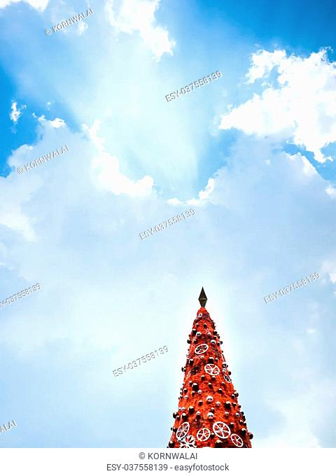 Beautiful decorated christmas tree with star and sparkle ball on Blue sky and beautiful clouds