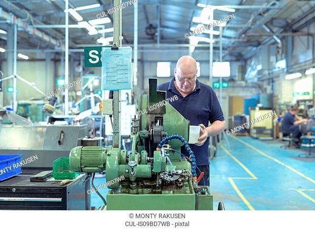 Engineer making fixings in engineering factory