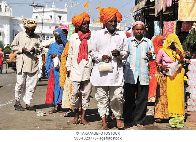 Pilgrim family out side of the Golden Temple, Punjab Amritsar India