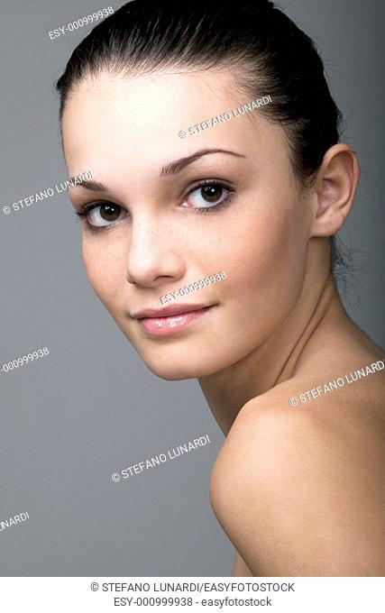 Portrait of a natural beauty on gray background