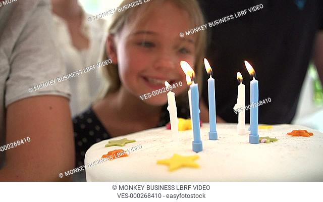 Girl blows out candles on birthday cake in slow motion sequence. Shot on Sony FS700 in PAL format at a frame rate of 200fps