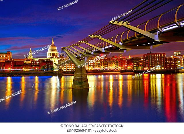 London Millennium bridge sunset skyline in UK at dusk