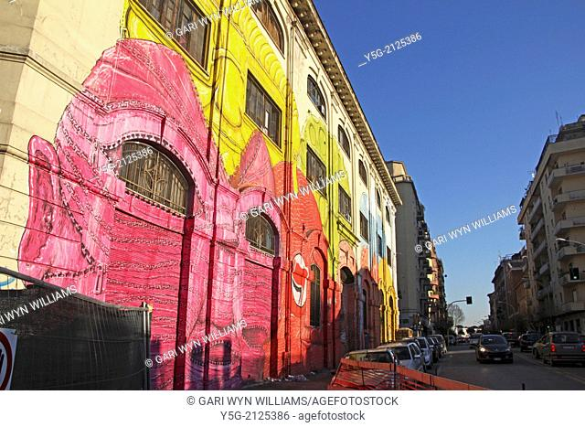 Rome, Italy. 24th Februrary 2014. Street Art by the artist Blu on an old military barracks building in the Ostiense district in Rome Italy