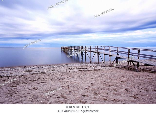 Matlock Beach and wooden pier on Lake Winnipeg at dusk. Lake Winnipeg, Manitoba, Canada