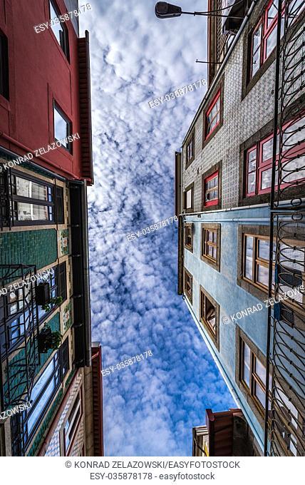 Tenement houses on a narrow street Rua do Pinheiro (Pine tree Street) in Porto city on Iberian Peninsula, second largest city in Portugal