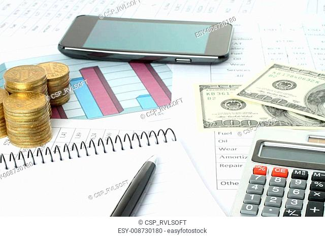 Business composition of graphs, tables, money and pen