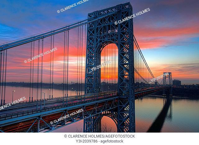 Morning rush hour traffic creates streaks of light on the George Washington Bridge as commuters cross the Hudson River between Fort Lee