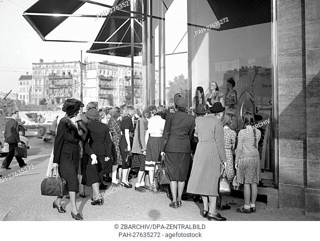 Women are jostling in front of the shopping windows of the Kaufhaus des Westens (KaDeWe, mall of the west), on Tauentzienstraße in West Berlin, pictured in 1950