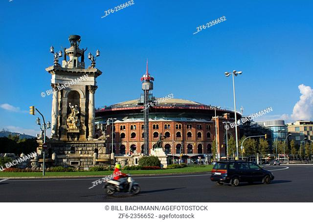 Barcelona Spain traffic in circle called Plaza de Espana and the Arenas which was the old bull arena ring