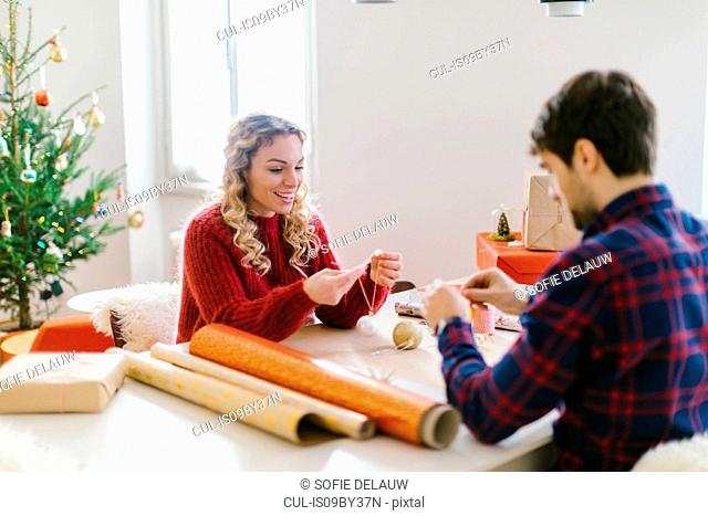 Couple preparing Christmas decorations at home