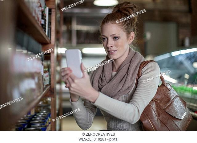 Woman taking a selfie in shop