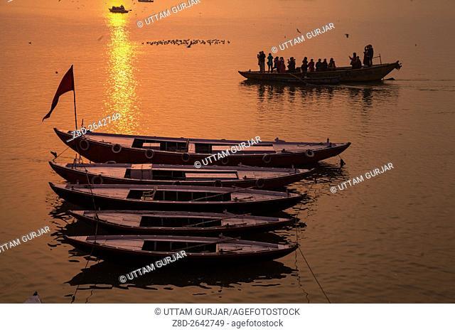 Boats at River Ganges during sunrise.Varanasi, Uttar Pradesh, India, Asia