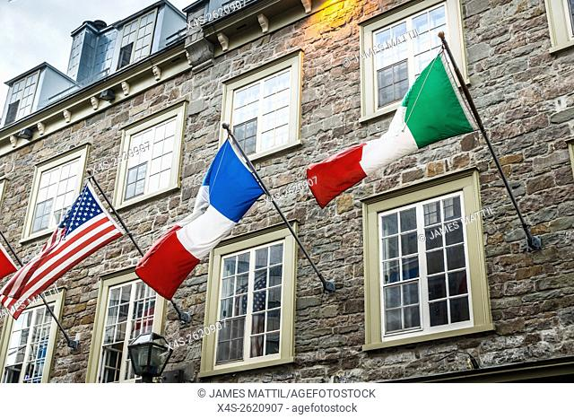 Colorful flags welcome international visitors to Quebec City