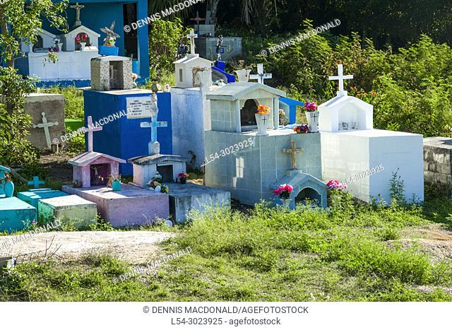 Local cemetery custom with colorful markers at the Cruise destination Costa Maya Mexico America is a popular stop on the Western Caribbean cruise ship tour and...