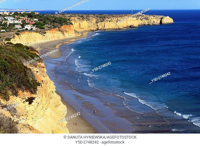 leisure on calm and beautiful Porto de Mos beach, Ponta da Piedade in background, Lagos, Algarve, Faro district, Portugal, Europe