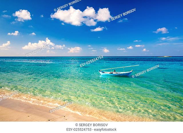 Beautiful ocean beach an boat on Maldives