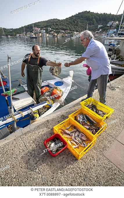 Fisherman selling the mornings catch on the quay in Vathy harbour. On the island of Ithaca, Ionian Sea, Greece
