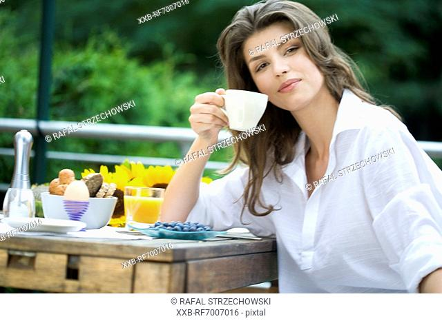 Woman drinking tea on the terrace