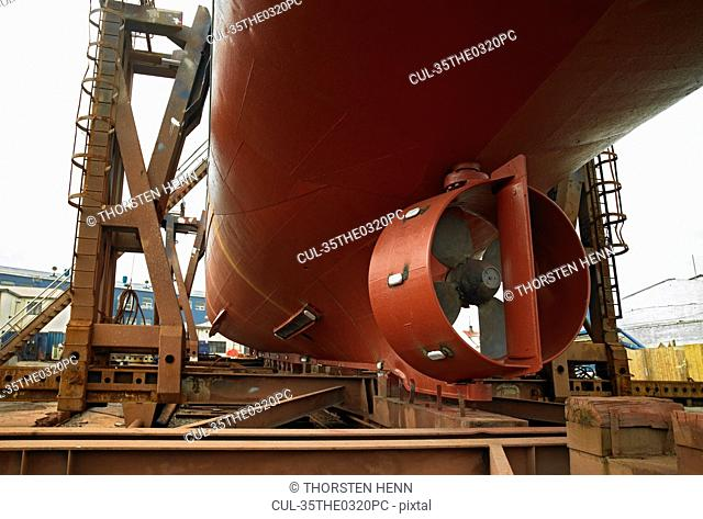 Turbine on underside of ship at dock