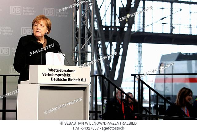 German Chancellor Angela Merkel (CDU) speaking on the stage at Leipzig main station in Leipzig, Germany, 09 December 2015