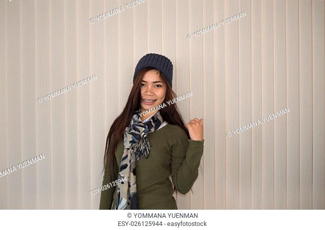 Beautiful woman in overcoat with curtain background, Portrait, Roi Et Thailand