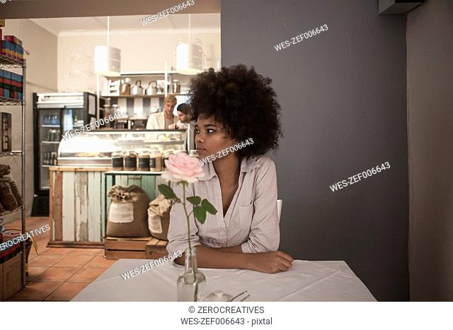 Young woman waiting in cafe