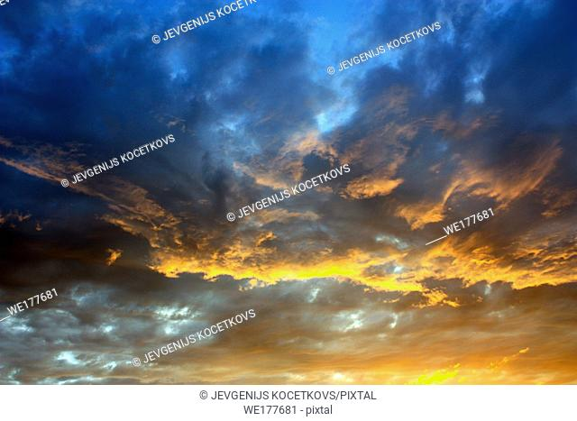 Dramatic color cloudy sky. Evening in the summer