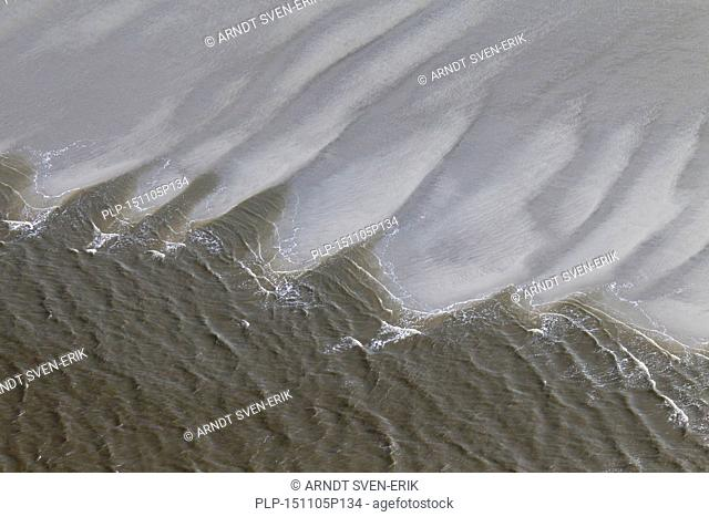 Aerial view of waves breaking on beach at the Schleswig-Holstein Wadden Sea National Park, Germany