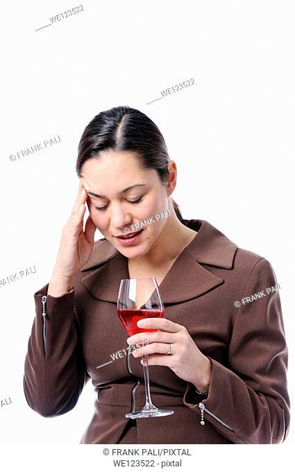 Young filipino women has her hand holding her head as if she has headache