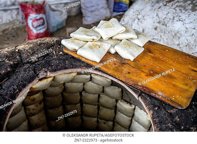 Traditional family bakery and small restaurant with tandoor, clay oven, where samsa, traditional Uzbek pastry with ground lamb and onion, are baked and served