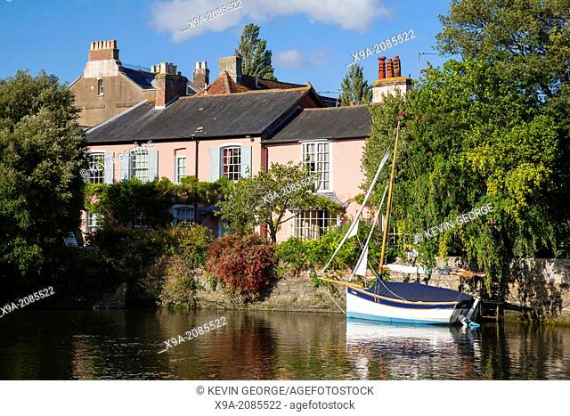 Boats and House on River Avon, Christchurch, Dorset, England, UK