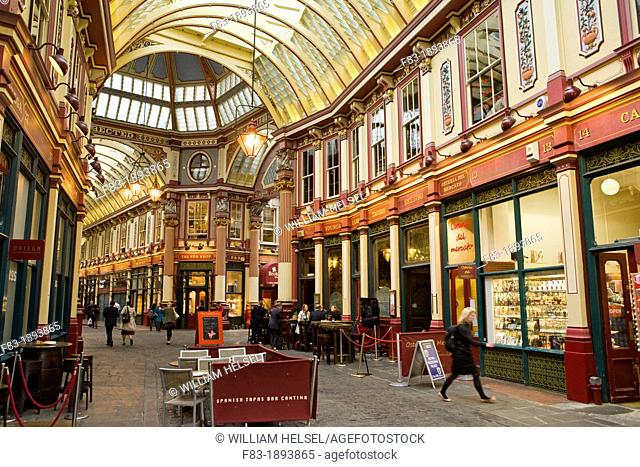 Business people and office workers drinking and shopping after work in Leadenhall Market designed 1881 by Sir Horace Jones, The City, London, England