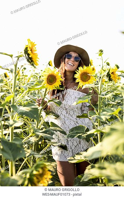 Happy woman in a sunflower field