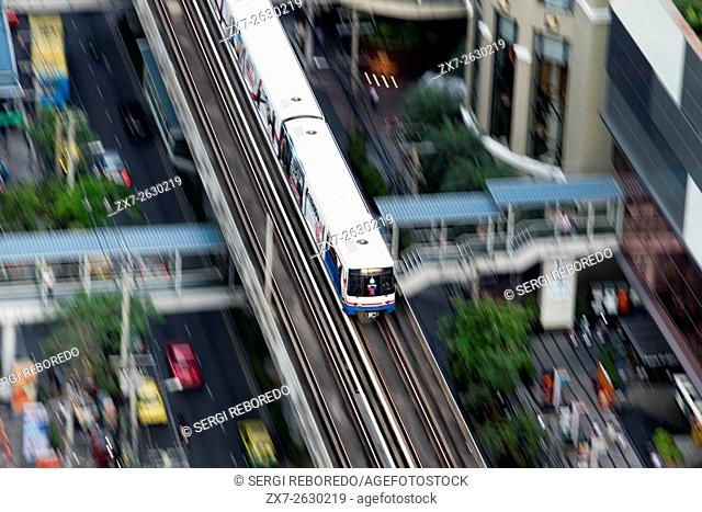 Aerial view of the sky train BTS in Sukhumvit. Skytrain BTS train en route over Sukhumvit in Bangkok city centre Thailand