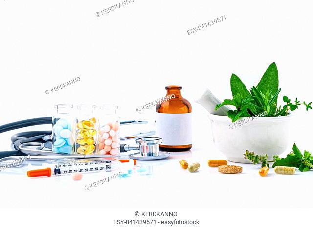 Herbal medicine VS Chemical medicine the alternative health care isolate on white background. White mortar and pestle with fresh herbs and herbal capsules