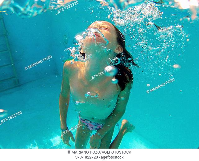 Girl into swimming pool
