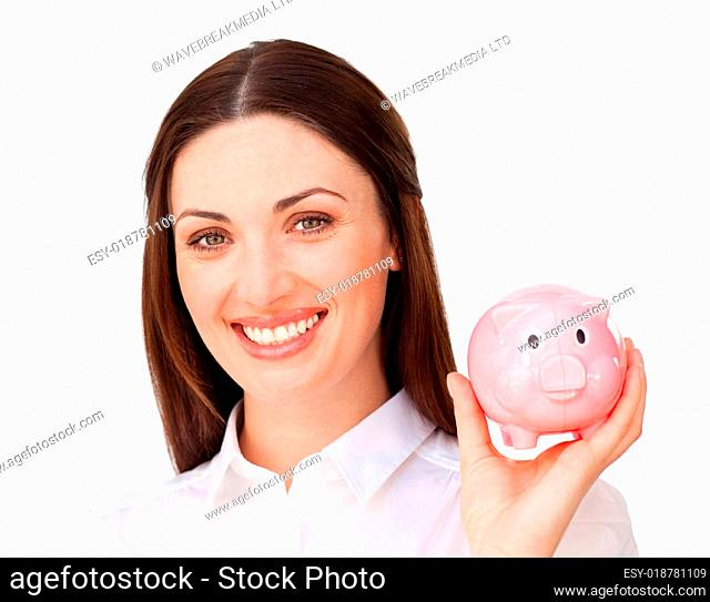 Smiling young businesswoman holding a piggybank