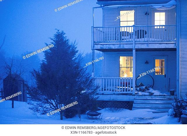 House in snow at night