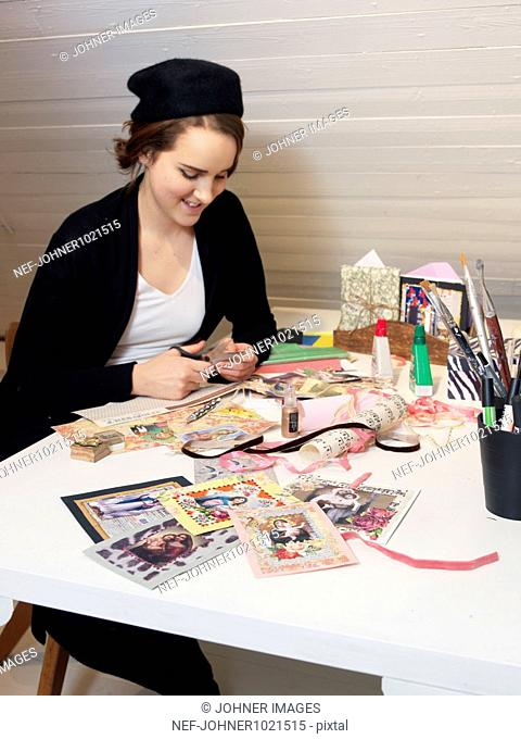 Woman making greeting cards during christmas