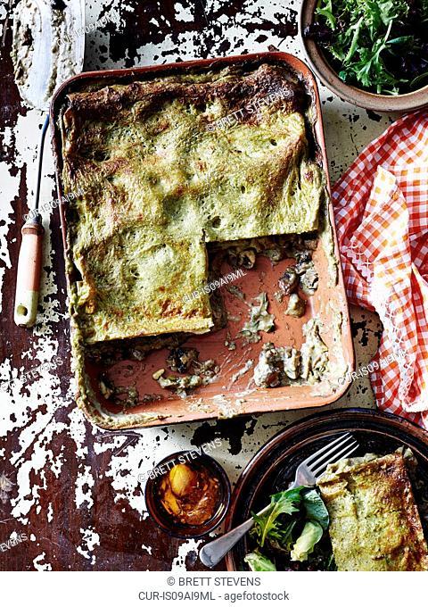 Still life of mushroom pesto lasagne and salad