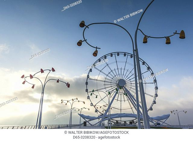 Azerbaijan, Baku, Bulvar Promenade, Baku Eye Ferris Wheel with morning fog, dawn