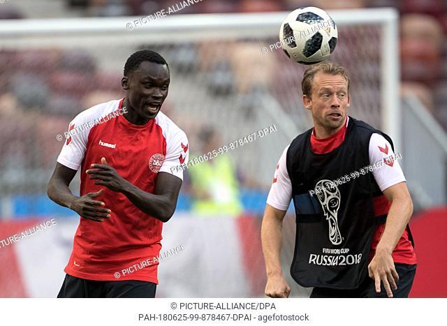 25 June 2018, Russia, Moscow: Soccer:FIFA World Cup 2018: Denmark's Pione Sisto (L) and Michael Krohn-Dehli in action at the Luzhniki Stadium
