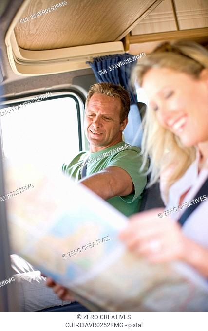 Couple reading map in RV
