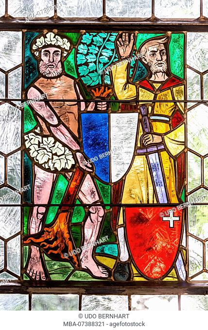 Colorful stained glass windows in Tellskapelle, Hohle Gasse between Küssnacht and Immensee at Lake Lucerne, canton Uri, Switzerland