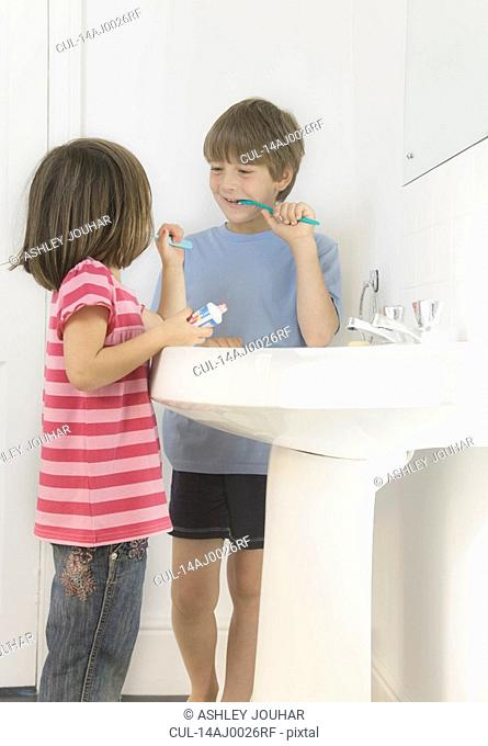 Boy and Girl cleaning teeth