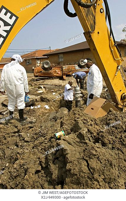 New Orleans, Louisiana - September 18, 2005 - City of New Orelans workers repair water mains and a fire hydrant in east New Orleans three weeks after Hurricane...