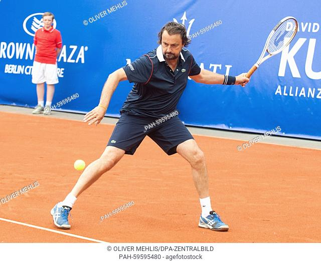 Former French tennis player Henri Leconte plays against his German opponent M. Stich at the Grand Champions Tournament in Berlin, Germany, 27 June 2015
