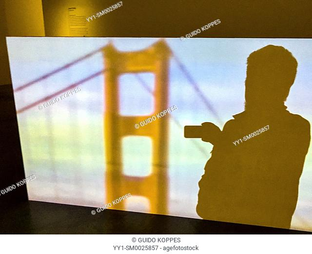 Breda, Netherlands. Shadow Selfie inside a projection of the Golden Gate Bridge on a photo museum's movie screen